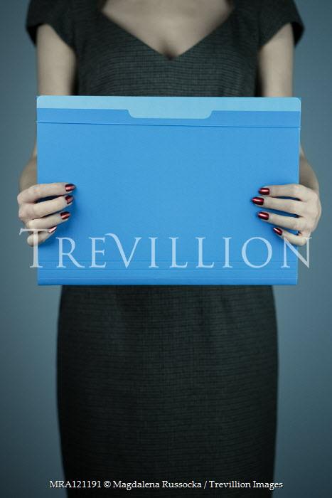 Magdalena Russocka close up of woman holding file folder