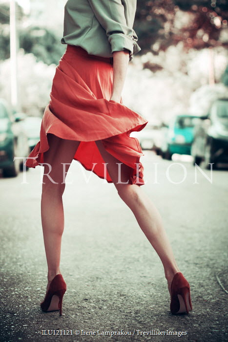 Irene Lamprakou Young woman walking on road
