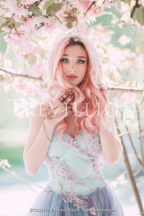 Jovana Rikalo Young woman with pink hair under tree
