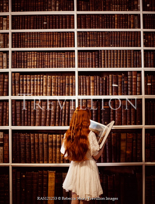 Rebecca Stice GIRL STANDING READING BOOK IN LIBRARY Women