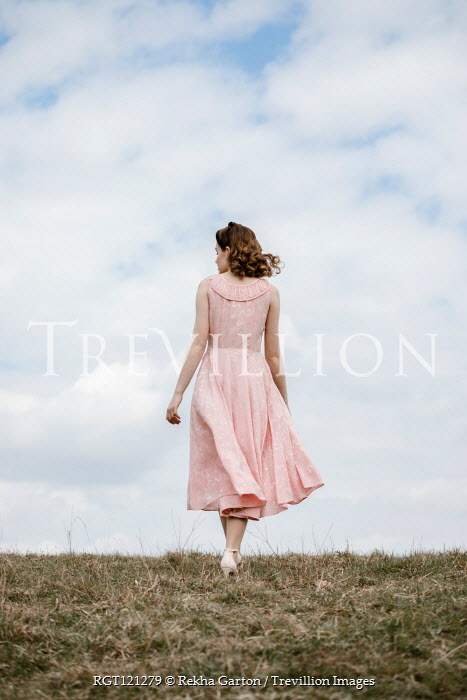 Rekha Garton GIRL IN PINK DRESS WALKING IN FIELD Women