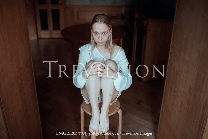Ulyana Naydenkova SAD BLONDE GIRL SITTIN ON STOOL INDOORS Women