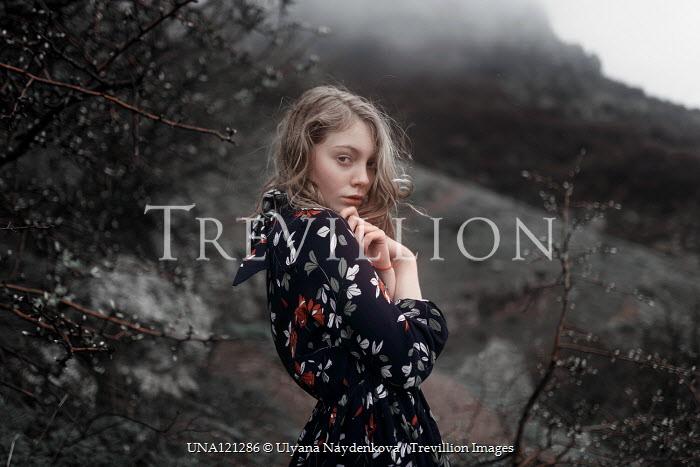 Ulyana Naydenkova GIRL IN FLORAL DRESS STANDING IN FOGGY COUNTRYSIDE Women