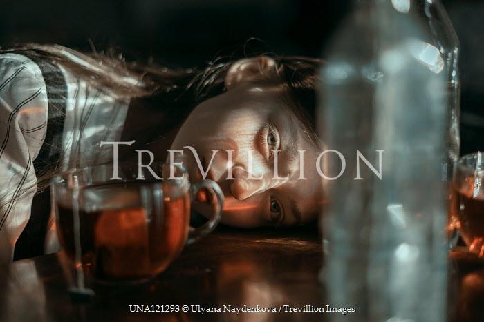 Ulyana Naydenkova GIRL LYING ON TABLE WITH GLASSES AND BOTTLES Children