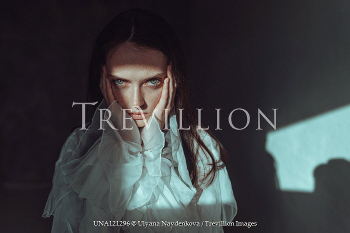 Ulyana Naydenkova STARING GIRL IN SILK BLOUSE HOLDING FACE Women
