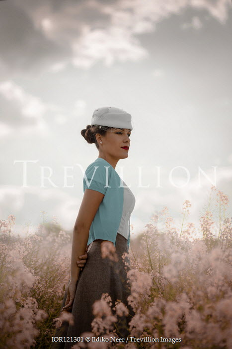 Ildiko Neer Retro woman standing in flower field