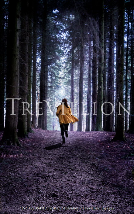 Stephen Mulcahey WOMAN IN YELLOW JACKET RUNNING IN FOREST Women