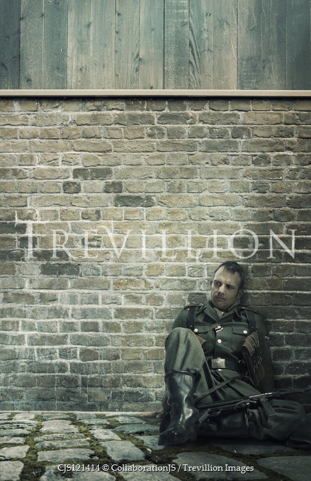 CollaborationJS GERMAN SOLDIER SITTING BY WALL OUTSIDE Men