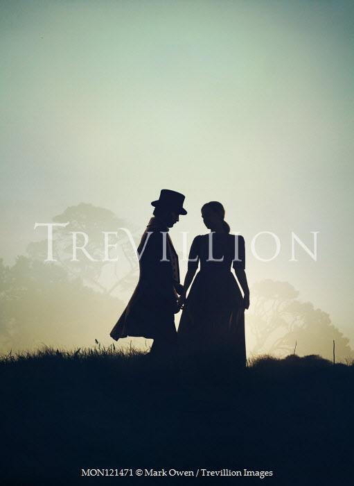Mark Owen SILHOUETTED HISTORICAL COUPLE IN COUNTRYSIDE Couples