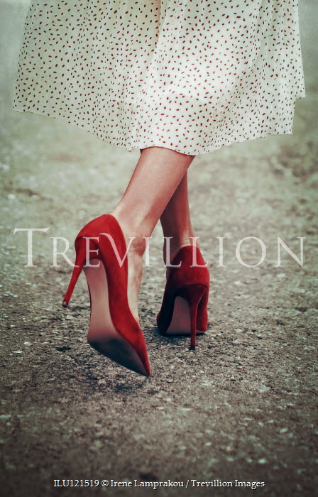 Irene Lamprakou Legs of woman in red high heels walking