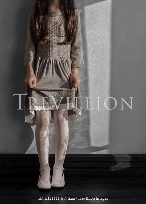Nikaa Girl in gray dress in shadow