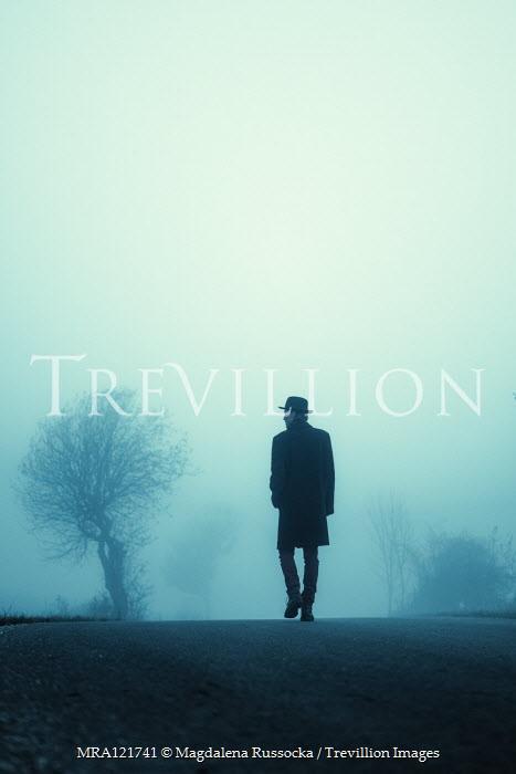 Magdalena Russocka man walking on foggy road