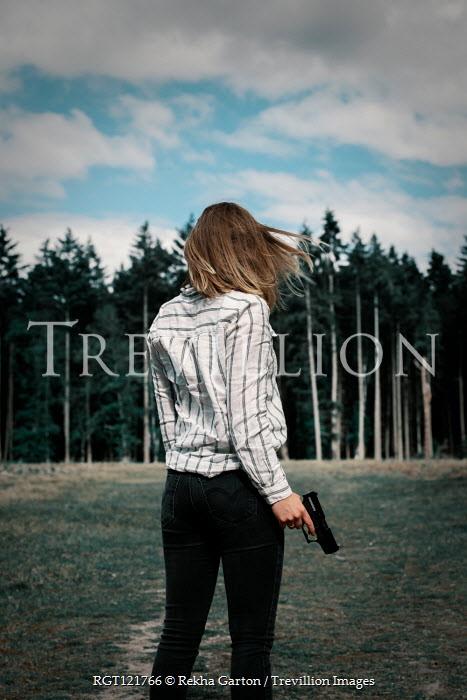 Rekha Garton WOMAN HOLDING GUN WATCHING FOREST Women