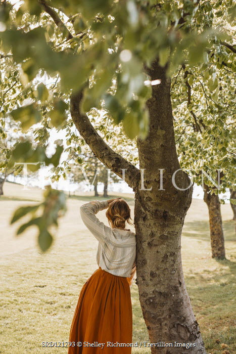 Shelley Richmond BLONDE WOMAN BY TREE IN SUMMERY COUNTRYSIDE Women