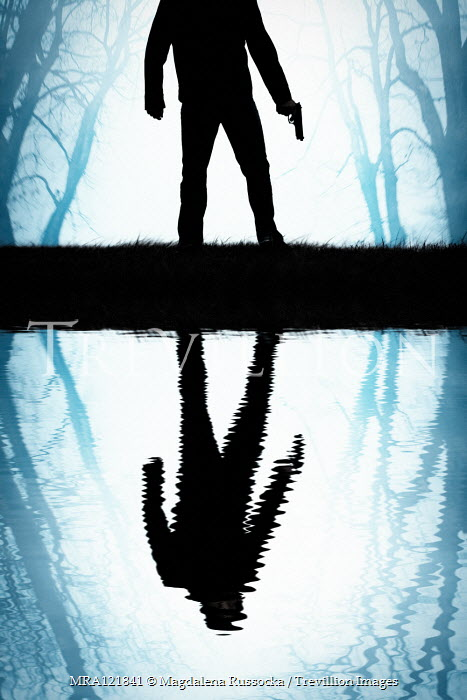 Magdalena Russocka silhouette of man with gun reflected in water