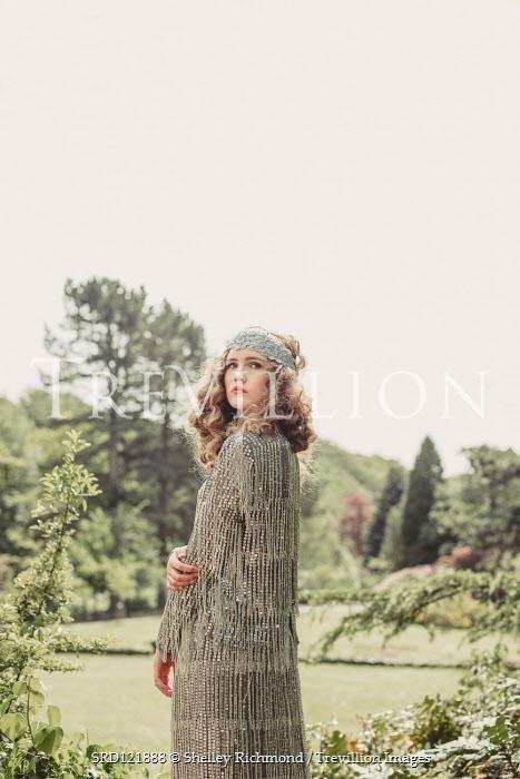 Shelley Richmond WOMAN IN GLITTERY DRESS IN SUMMERY GARDEN Women