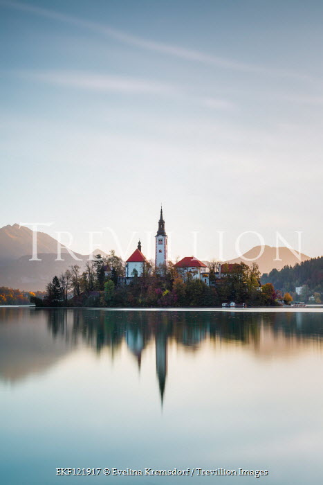 Evelina Kremsdorf CHURCH ON ISLAND WITH LAKE AND MOUNTAINS Religious Buildings