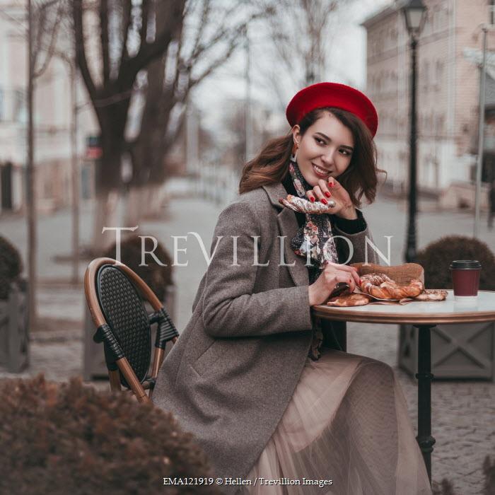 Hellen WOMAN EATING OUTDOORS IN CAFE IN WINTER Women