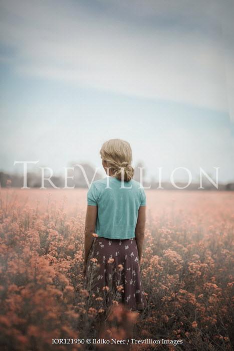 Ildiko Neer Blonde hair woman standing in flower field