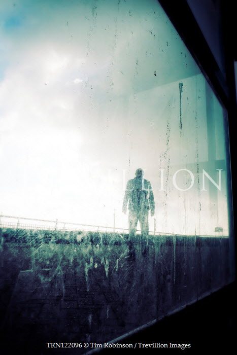 Tim Robinson MAN STANDING ON ROAD IN FRONT OF DIRTY WINDOW Men