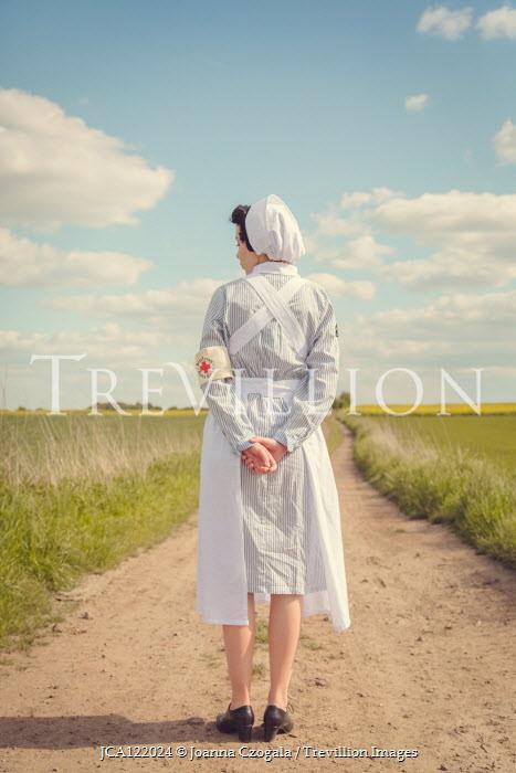 Joanna Czogala RETRO NURSE STANDING ON COUNTRY ROAD Women