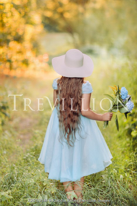 Klaudia Rataj YOUNG GIRL WITH HAT AND FLOWERS IN SUMMERY COUNTRYSIDE Children