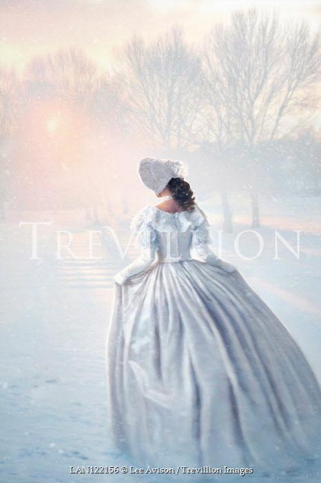 Lee Avison victorian woman running in snowy landscape