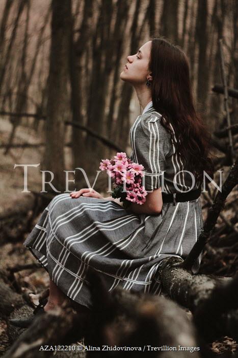 Alina Zhidovinova GIRL SITTING IN FOREST HOLDING PINK FLOWES Women