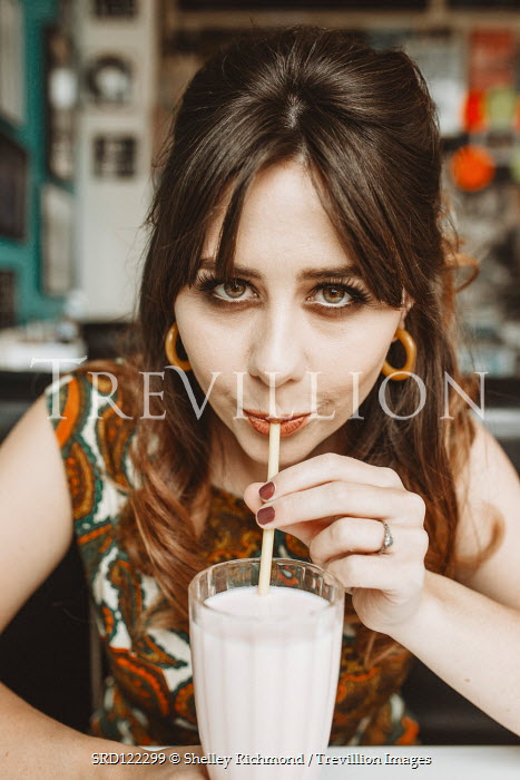 Shelley Richmond 1960S WOMAN DRINKING MILKSHAKE INSIDE CAFE Women