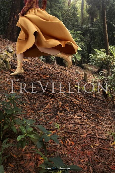 ILINA SIMEONOVA Legs of woman in skirt running in forest