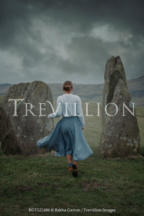Rekha Garton WOMAN BY STANDING STONES IN STORMY COUNTRYSIDE Women
