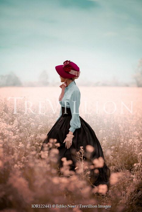 Ildiko Neer Victorian woman standing in flower field