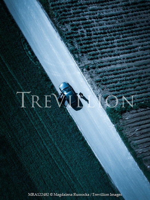 Magdalena Russocka aerial view of walking man and car on road