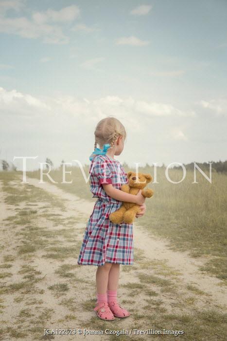 Joanna Czogala BLONDE LITTLE GIRL HOLDING TEDDY IN COUNTRYSIDE Children
