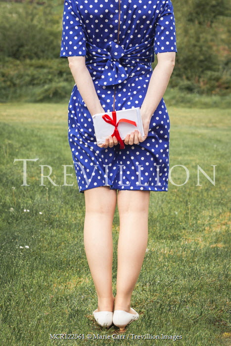 Marie Carr WOMAN IN POLKA DOT DRESS HOLDING LETTERS IN COUNTRYSIDE Women