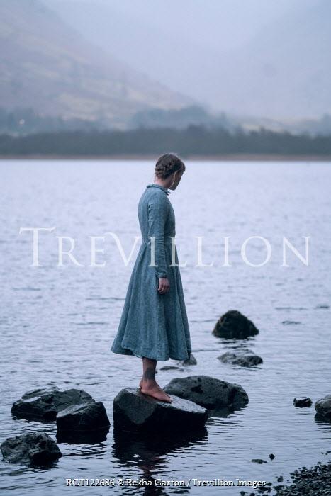 Rekha Garton BAREFOOT GIRL STANDING ON STONE IN LAKE Women