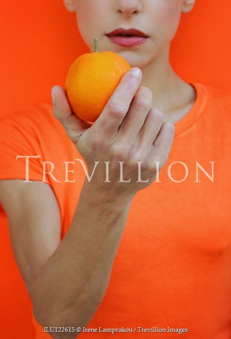 Irene Lamprakou WOMAN IN ORANGE T-SHIRT HOLDING FRUIT Women