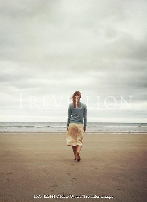 Mark Owen BLONDE BAREFOOT WOMAN WALKING ON SANDY BEACH Women