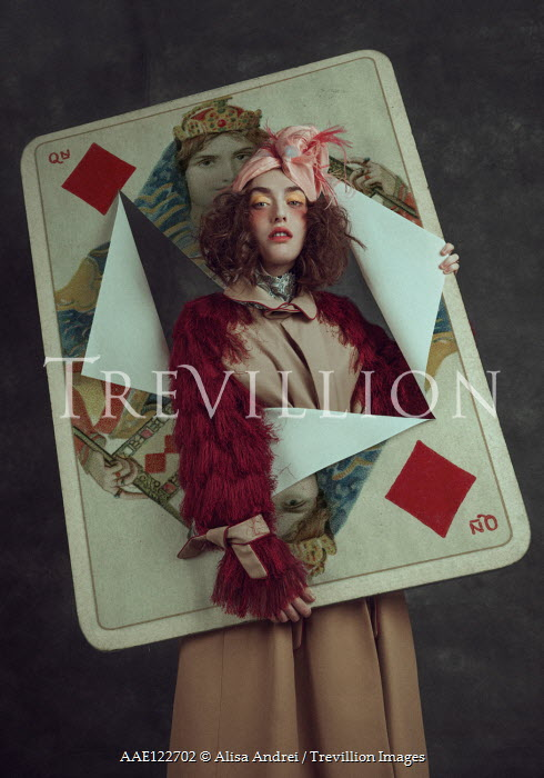 Alisa Andrei Young woman with torn oversized playing card