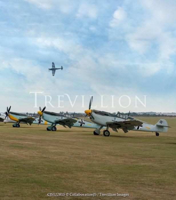 CollaborationJS 4 Messerschmitt Bf 109 at an airfield