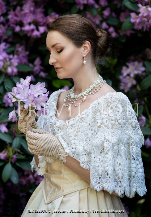 Jaroslaw Blaminsky WOMAN WITH PEARLS AND LACE OUTDOORS WITH FLOWERS Women
