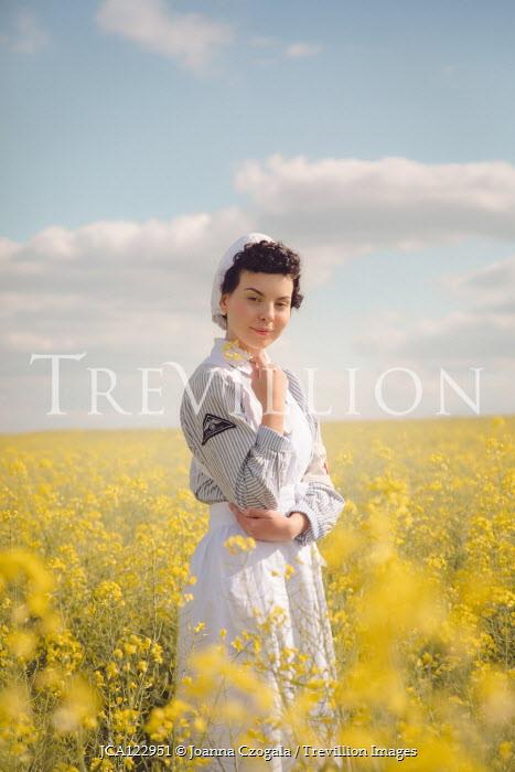 Joanna Czogala HAPPY NURSE IN FIELD OF YELLOW FLOWERS Women