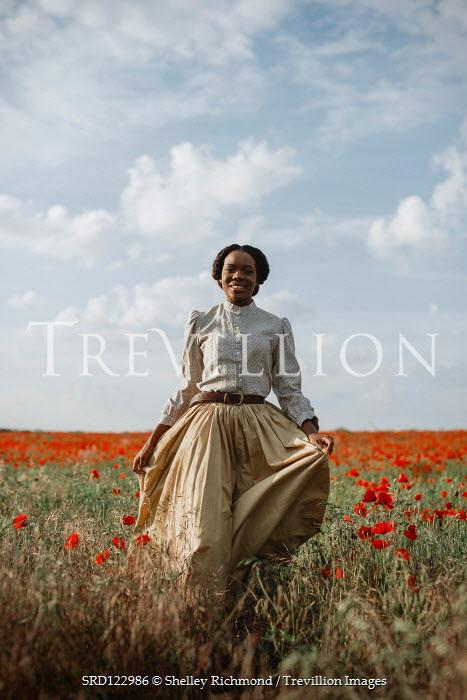 Shelley Richmond HAPPY BLACK WOMAN WALKING IN POPPY FIELD Women