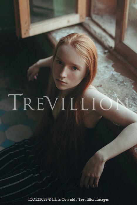 Irina Orwald GIRL WITH RED HAIR SITTING ON FLOOR BY WINDOW Women