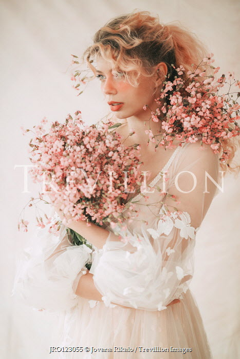 Jovana Rikalo BLONDE WOMAN IN WHITE HOLDING PINK FLOWERS Women