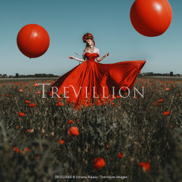 Jovana Rikalo WOMAN IN FIELD WITH RED BALLOONS AND POPPIES Women