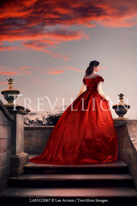 Lee Avison WOMAN IN RED GOWN ON STEPS AT SUNSET Women