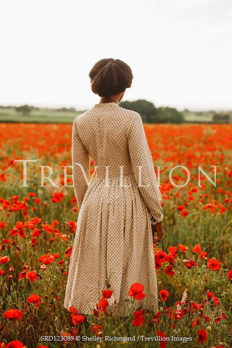 Shelley Richmond BLACK WOMAN STANDING IN POPPY FIELD Women