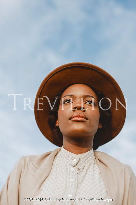 Shelley Richmond SERIOUS BLACK WOMAN WITH BLUE SKY Women