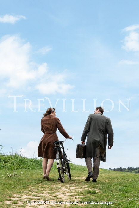 CollaborationJS WOMAN WITH BIKE WALKING WITH MAN IN COUNTRYSIDE Couples